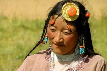 Tibetan woman and coral head dress
